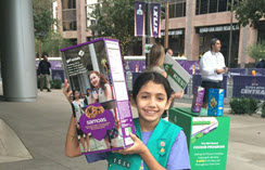 Girl-Scout-advertising-sales-on-the-corner-at-Super-Bowl-Central